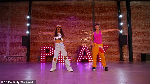 Professional: Antin rocked a cut-off tank top with a black sports bra and distressed high-waisted jeans while grooving