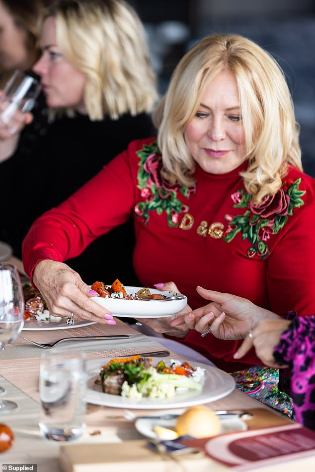 Bold: The 67-year-old wore a bold red Dolce & Gabbana sweater