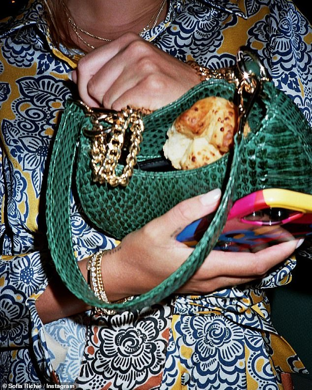 Extra storage: Richie also included a shot of her opening a purse and showing her followers where she had hidden what appeared to be a baked good