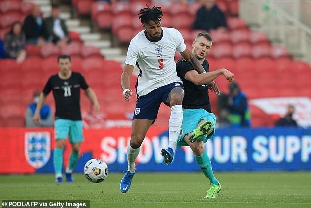 Mings battles Kalajdzic for the ball in a separate incident during England's 1-0 victory