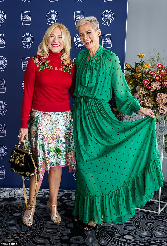 Beaming: She opted for a bright and vibrant red turtleneck sweater with floral embellishments, by Dolce and Gabbana, teamed with a floral sequin skirt.Alongside her was fellow former Studio 10 presenter Jessica Rowe in a flowy emerald green dress with polka dots