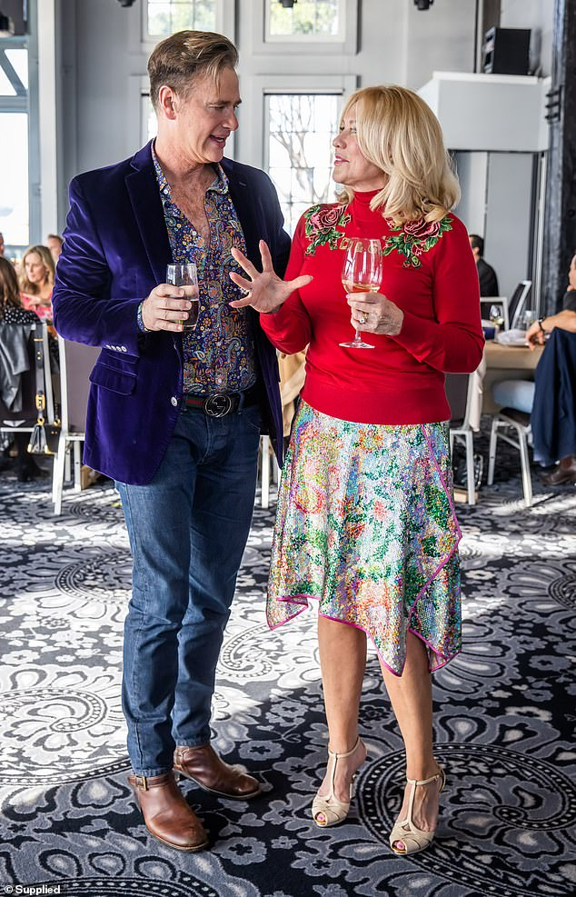 Catching up: The 67-year-old TV legend was seen enjoying a lively conversation with her friend and entertainment reporter Richard Reid.He teamed a purple velvet blazer with a paisley button down, a Gucci belt and jeans