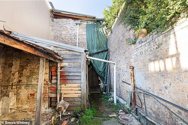 Shanty or a steal? 463 Liverpool Street is a two-storey Victorian terrace that is an ugly duckling but could also be a profitable project for buyers, It is up for sale for $1.68million but after a refurbishment could re-sell for up to $2.5million. The courtyard is pictured