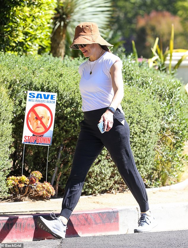 Fit:The 49-year-old actress showcased her toned arms in white tee with cap sleeves