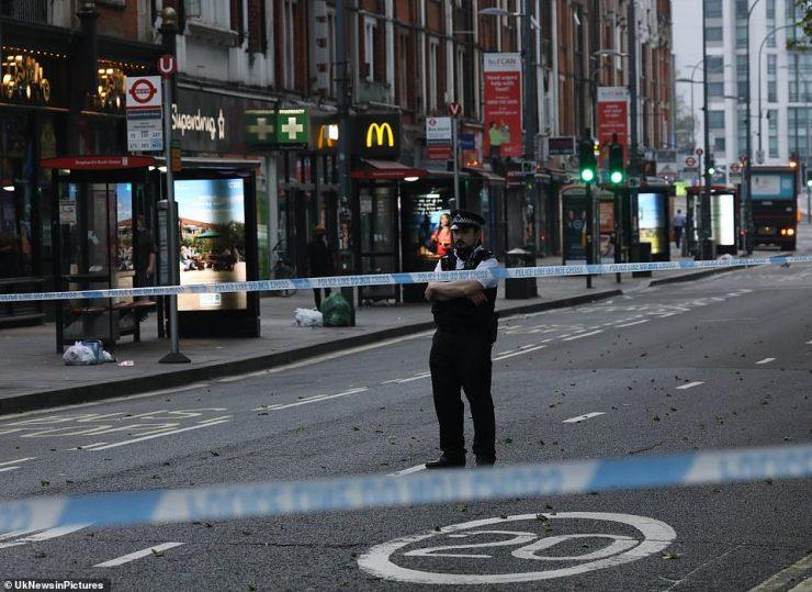SHEPHERD'S BUSH: A police officer standing by a cordon in Shepherd's Bush, west London, after a stabbing