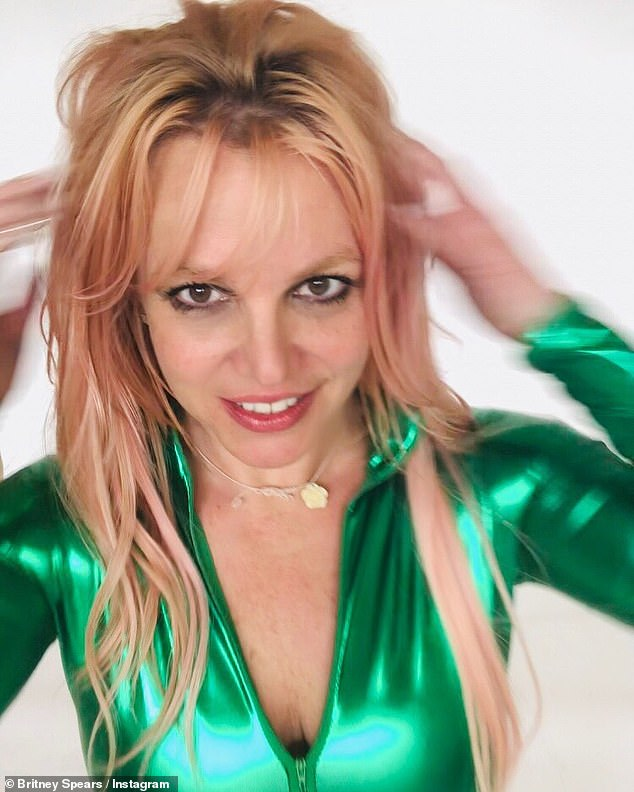 Green with envy: Britney Spears, 39, put on another racy display as she posed up a storm wearing a green zip-up catsuit for her 30million followers to enjoy
