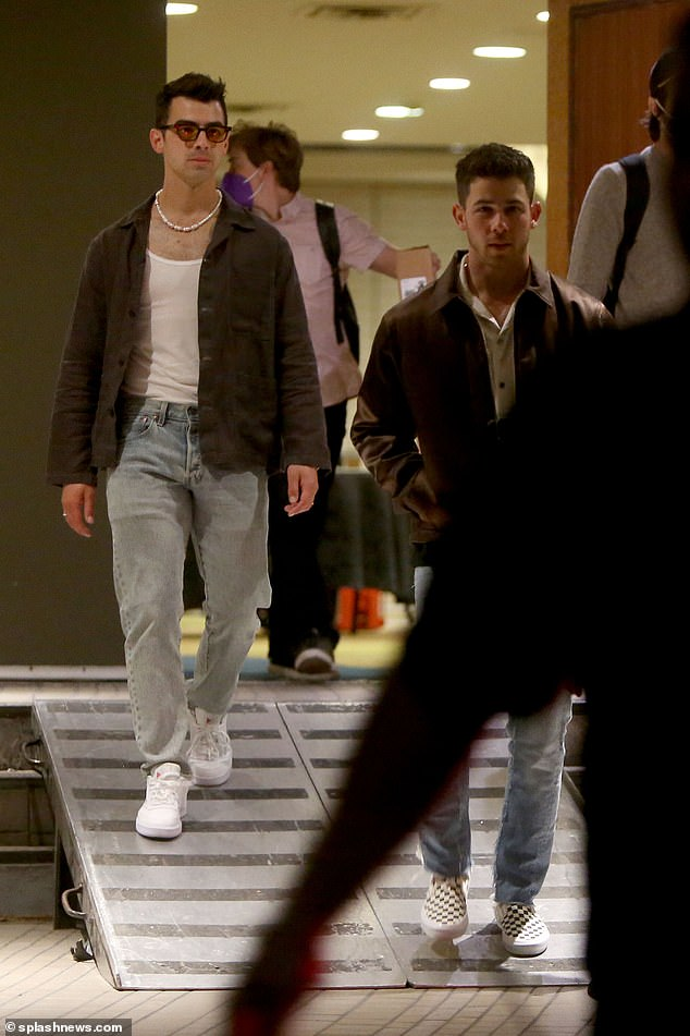 Casual:Joe wore an almost identical outfit with the same jacket and jeans which he wore with a vest and a pair of sunglasses