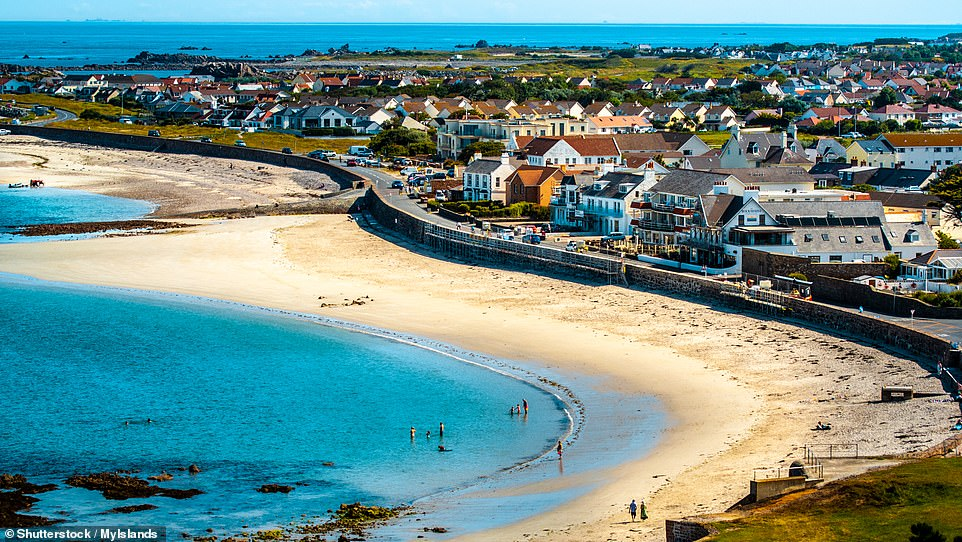 Popular beaches on Guernsey are the huge sweeps of white sand at Vazon Road, Cobo Bay (pictured) and L'Ancresse Common