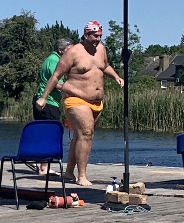 Happy and healthy: James Argent continued to improve his fitness by swimming at Hackney Reservoir on Tuesday after shedding four stone following gastric band surgery