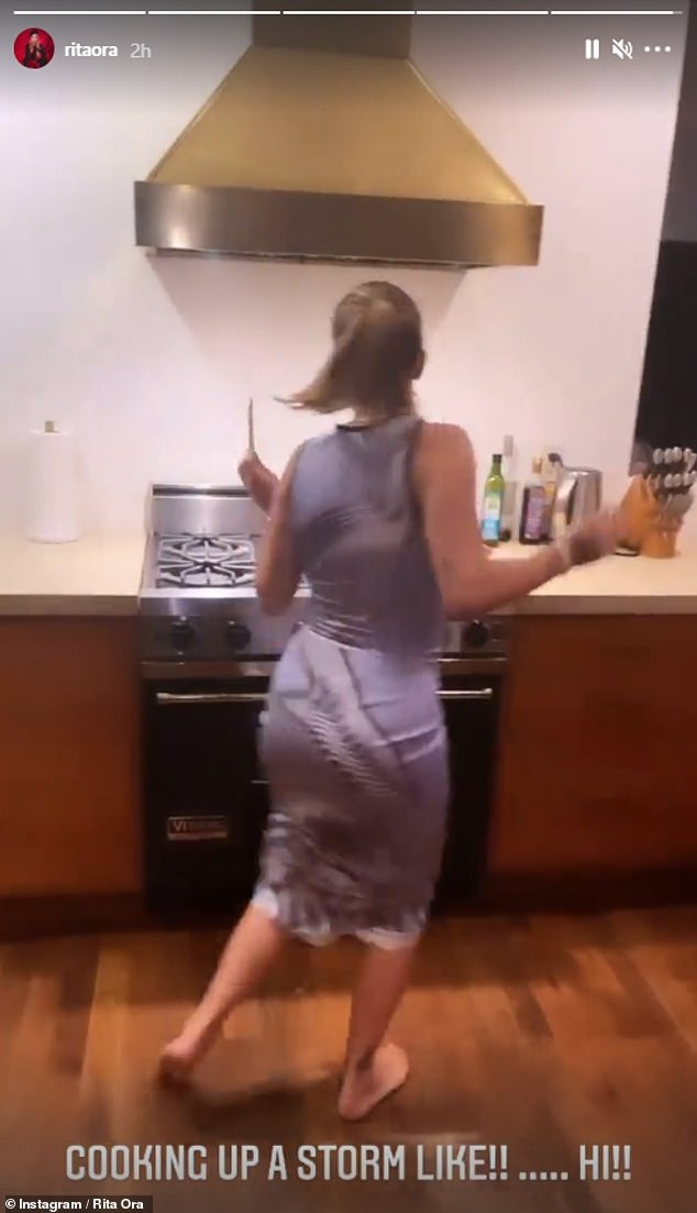 Dancer: She also showed off her impressive moves and span around her kitchen