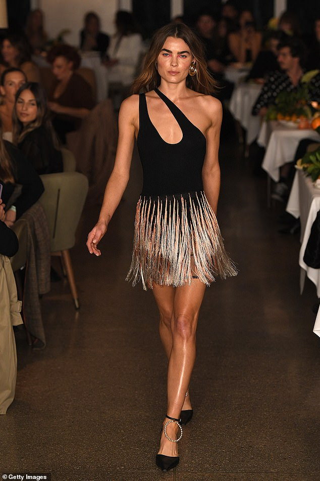 Keeping it short: Another look saw her showing off her long legs in a black mini-dress with fringing on the skirt