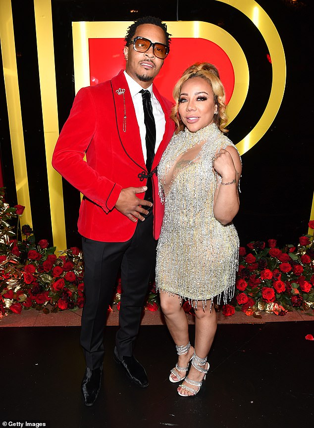 Style:The couple dressed to impress at the black tie affair as they celebrated the music manager Pierre Thomas' birthday, with Tiny, 45, (real name Tameka Cottle) pulling out all the stops in a glittering cut-out gold dress
