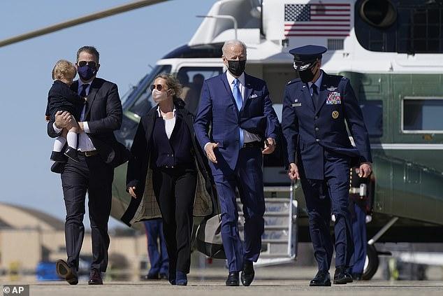 President Joe Biden walks with his son Hunter Biden, left, Hunter Biden's wife Melissa Cohen and son Beau, in March
