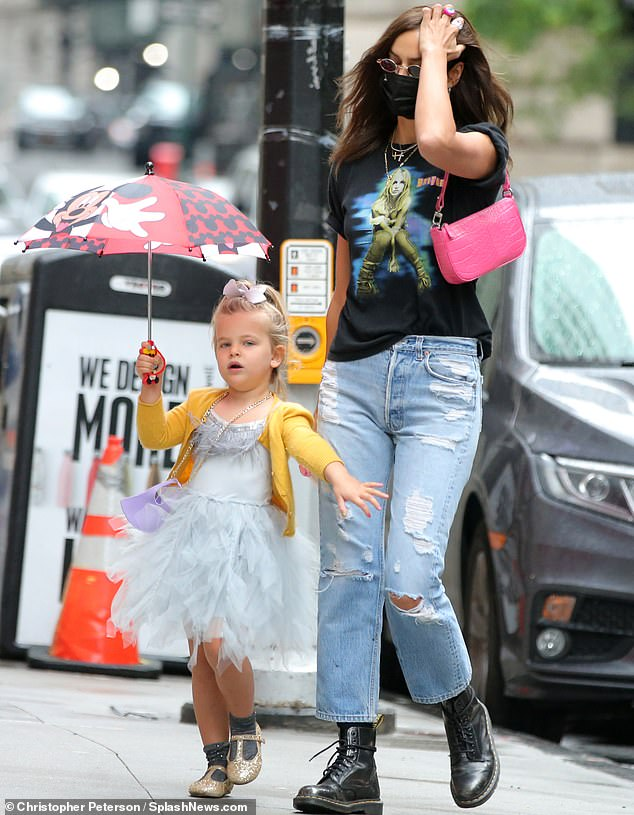 Quality time:The Russian model dressed her little girl in a princess dress before they stepped out for a stroll together in rainy New York City