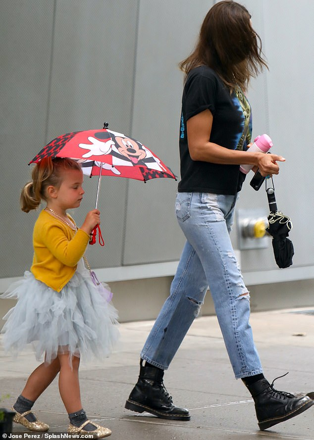 So sweet:Irina made sure her little princess was ready for a downpour as Lea was seen carrying a Disney umbrella