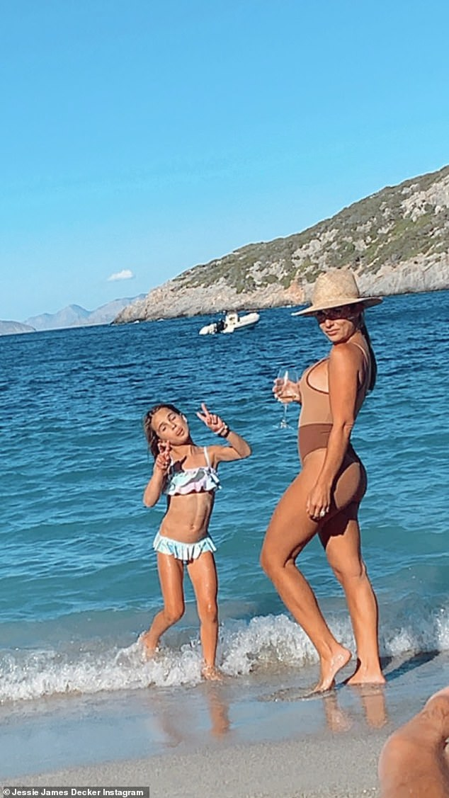 Hot mama! Jessie James Decker showed off her incredible body as she frolicked on the beaches of Greece with her daughter Vivianne Rose Decker, seven, on Thursday