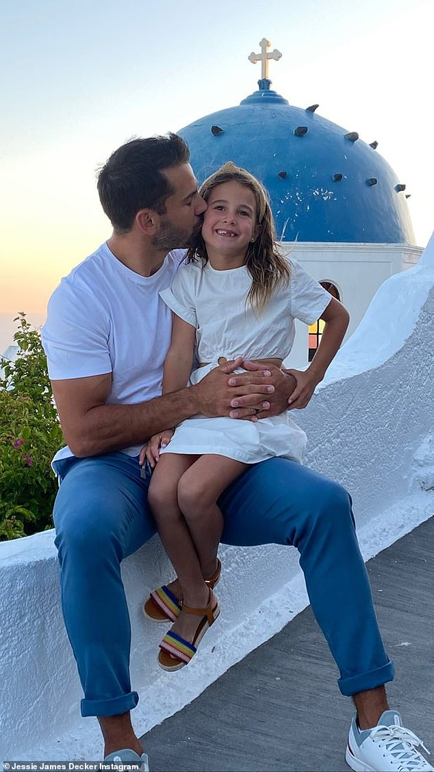Daddy's little girl: Eric planted a kiss on his daughter's cheek