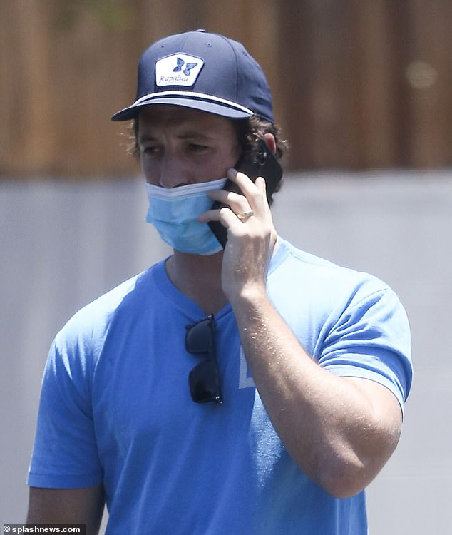 Ouch:Miles Teller was pictured with a black eye as he was seen for the first time since being allegedly attacked by two men and punched in the face in a restaurant bathroom in Maui, Hawaii