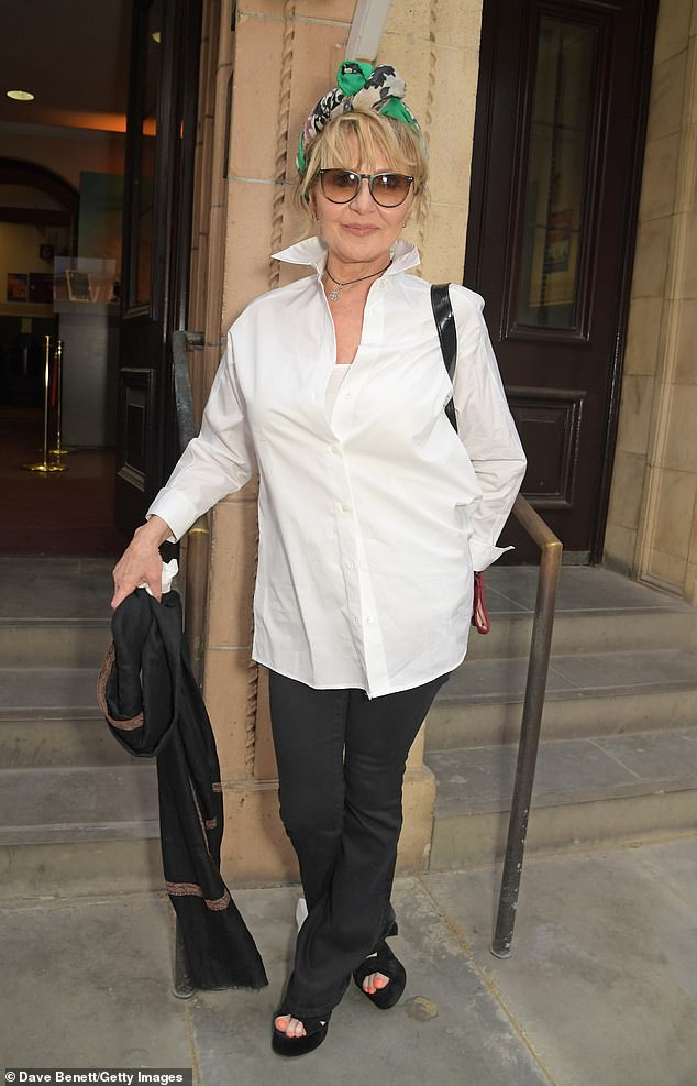Stylish:Lulu looked stylish in a white shirt and black trousers