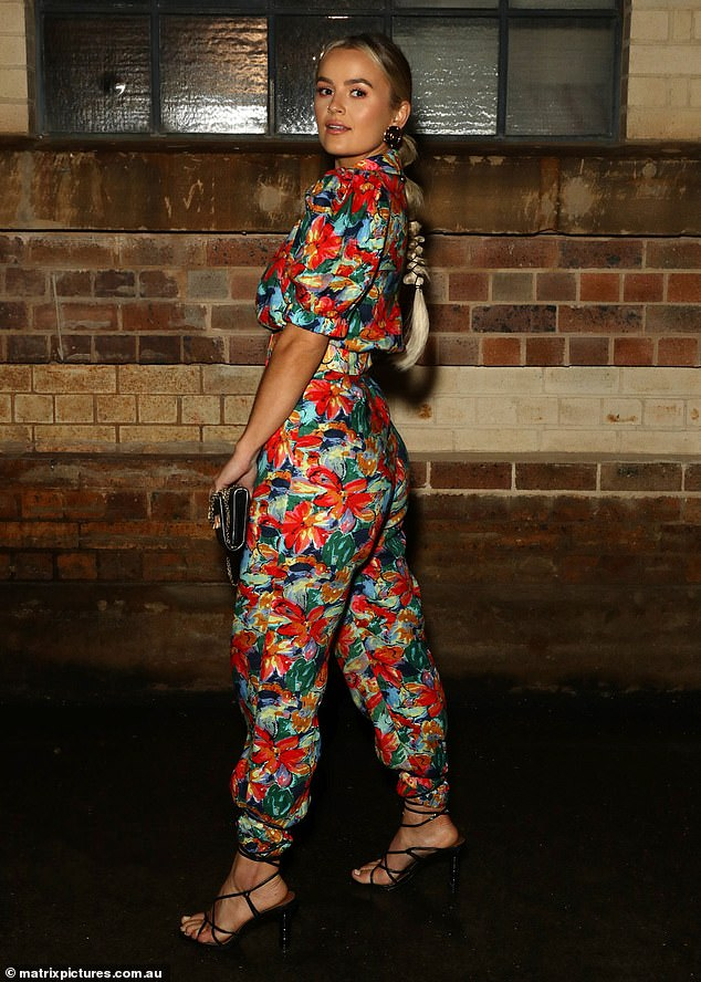 Vibrant beauty: Elly, 26, donned a vibrant floral jumpsuit by Australian designer Elliatt, which she teamed with some strappy black heels