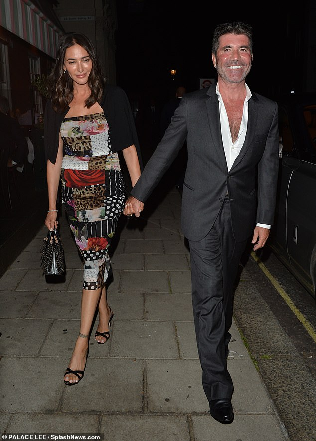 Date night: The couple were seen heading home together after enjoying a double date night at Harry's Bar in London