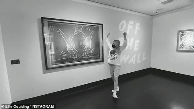Poignant: Ellie poses next to a piece of art work celebrating pregnancy