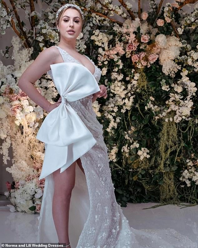 She's a natural:In the pictures, the brunette appears to be a natural as she poses in a few of the elegant gowns