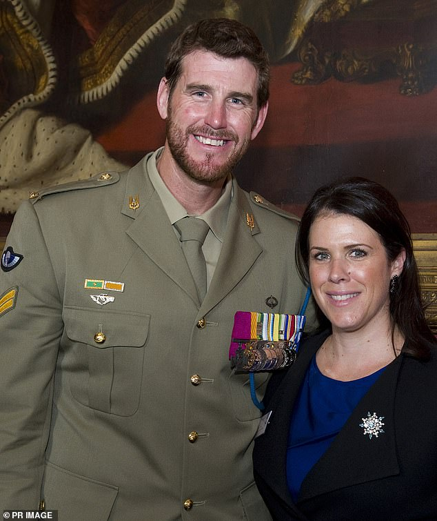 Mr Roberts-Smith's ex-wife Emma has 'flipped' and is giving evidence for Nine Entertainment. The former couple is pictured together at a reception to celebrate military and civilian heroes in London in 2012