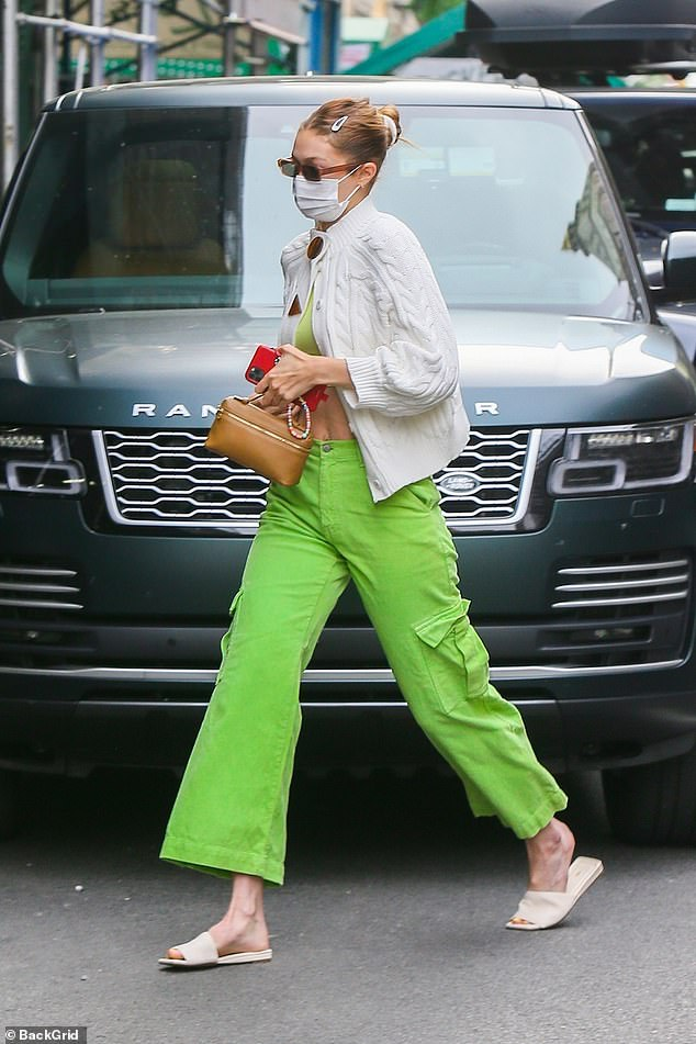 Stunner:Gigi Hadid flashed her toned tummy as she ran errands in New York City on Thursday afternoon