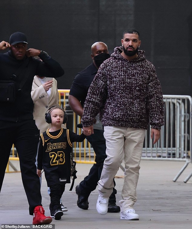 On Thursday night: Drake was seen accompanying his young son Adonis Graham to the Lakers basketball game at the Staples Center in Los Angeles