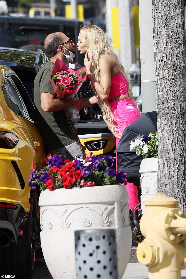 Thanks hon! Quinnappeared to purchase a bouquet of flowers for her husband of 18 months, Christian Richard, who leaned against his yellow sports car