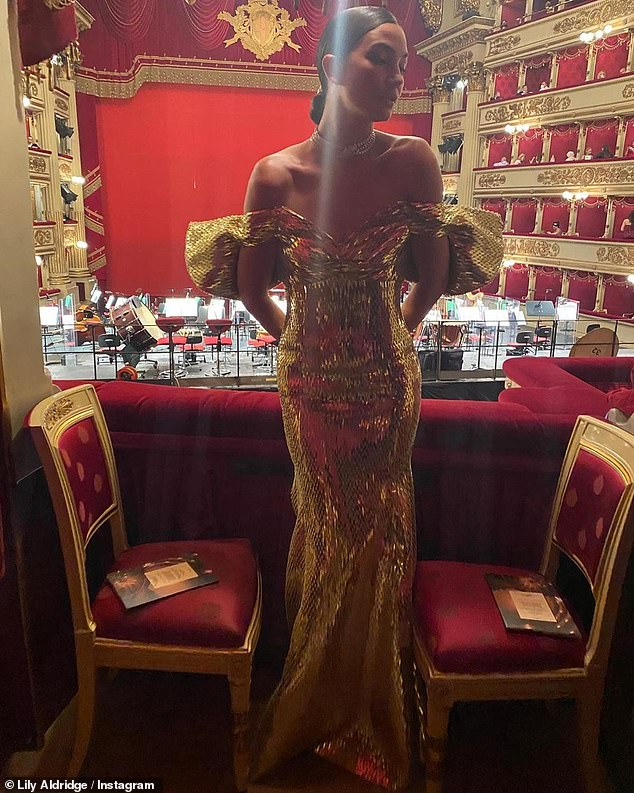Turn heads: Lily Aldridge stole the show on Thursday as she went to the opera in Italy, clad in a showstopper gold gown and uploaded the sensational snaps to Instagram
