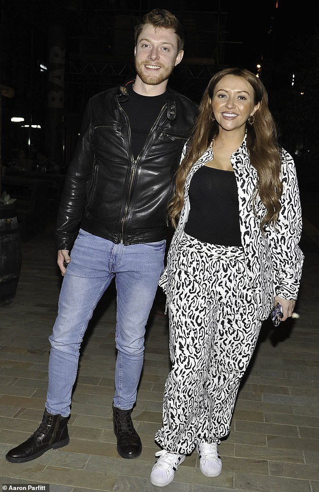 Wild thing: On Thursday night, Kimberly Hart-Simpson, 34, commanded attention in a loud co-ord set as she enjoyed a boozy reunion with her Coronation Street co-star Rob Mallard, 29