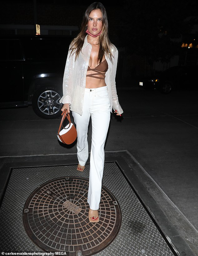 Unbuttoned: Alessandra Ambrosio highlighted her washboard stomach and pert assets in a strappy brown bralette on Thursday as she arrived for dinner at Gigi's in Los Angeles