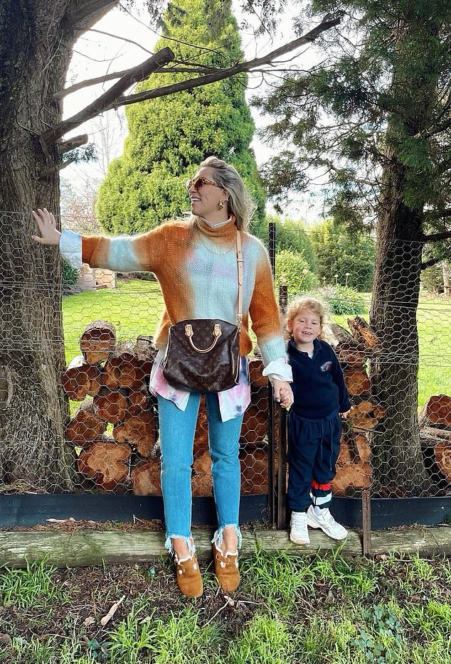 New house: Phoebe Burgess has revealed she has bought her own home in the Southern Highlands. Pictured at the property with her daughter Poppy