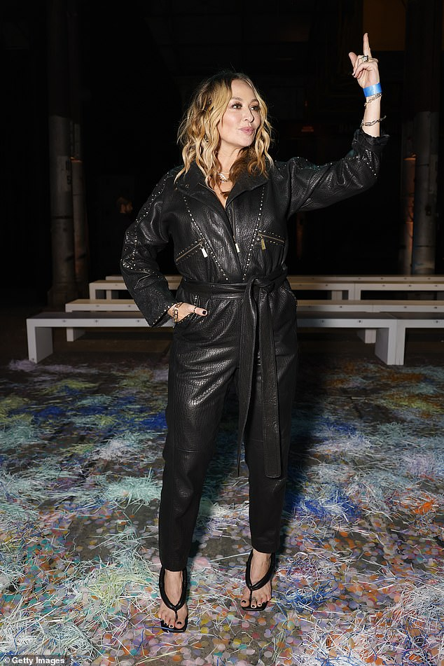 New look:The 45-year-old, who is known as 'Kaftan Queen', left her trademark kaftan at home and showed up in an edgy black jumpsuit