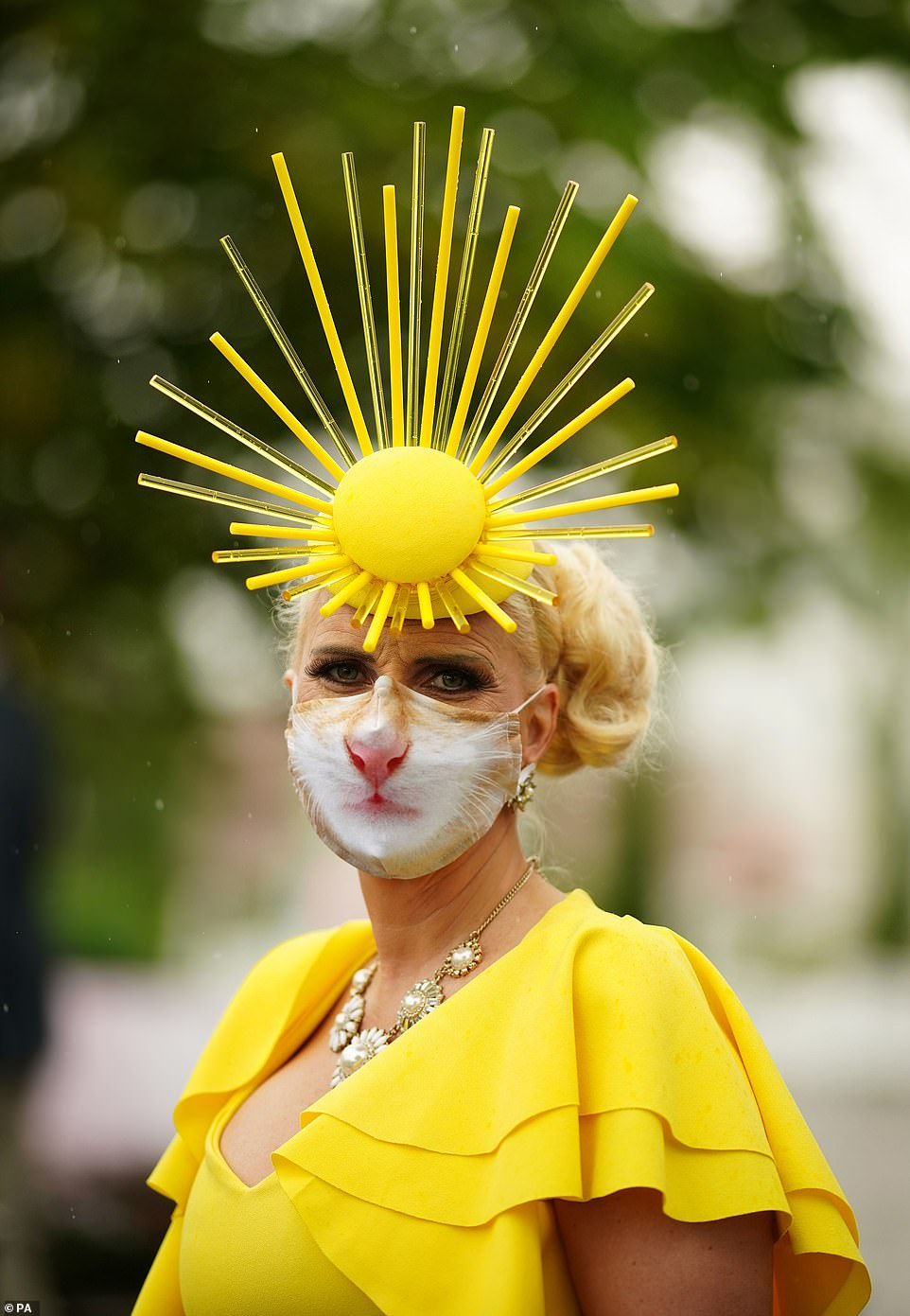 Now that's accessorising! One woman matched her impressive lion mane-like fascinator with her protective face mask