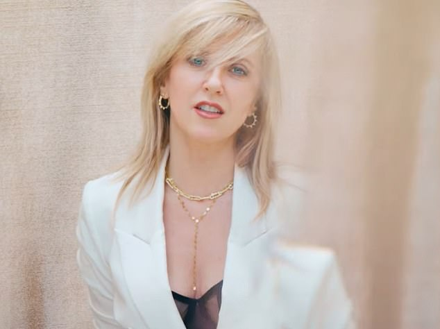 She's back:Indie rocker Liz Phair seen in her new music video The Game... as she returns with critically-acclaimed album, Soberish, after an 11 years hiatus
