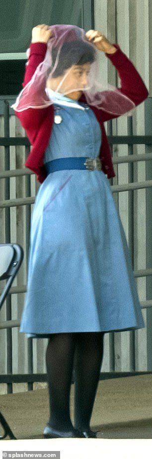 In costume: Leonie transformed back into her role as Lucille - the show's first black midwife - donning her blue nurses dress teamed with a burgundy cardigan and matching cap