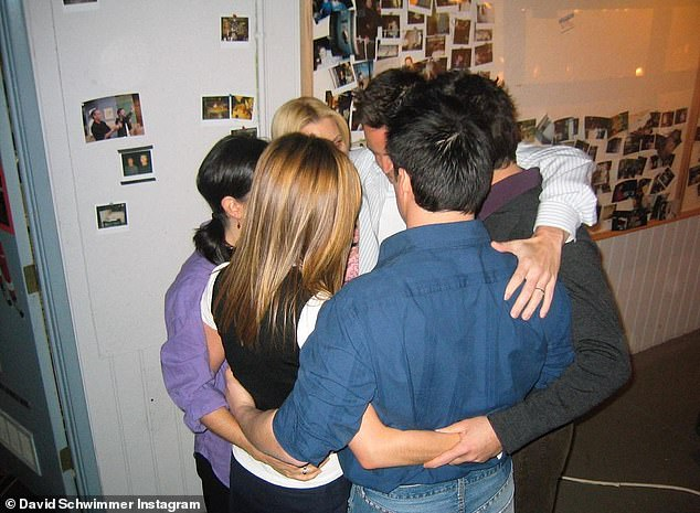 How it was: Schwimmer also included a photo of the cast huddle during the filming of the last ever episode of Friends in 2004