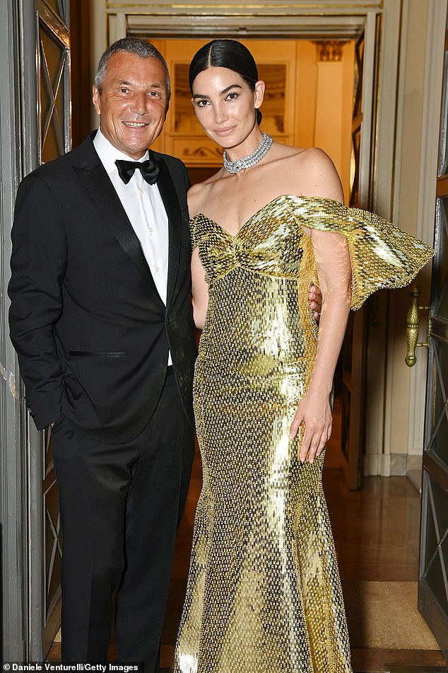 A vision: She posed up a storm with chief executive of Bulgari Jean-Christophe Babin