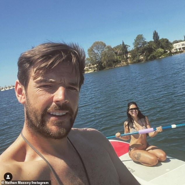 Looking good:Cara De La Hoyde looked just as stunning five years on as she flaunted her figure in a Burberry bikini while paddle boarding with husband Nathan Massey in Portugal on Friday
