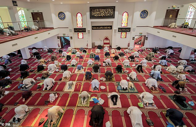 According to the author, there were mosques 'on almost every corner' in Bradford (pictured, worshippers at Bradford Central Mosque)