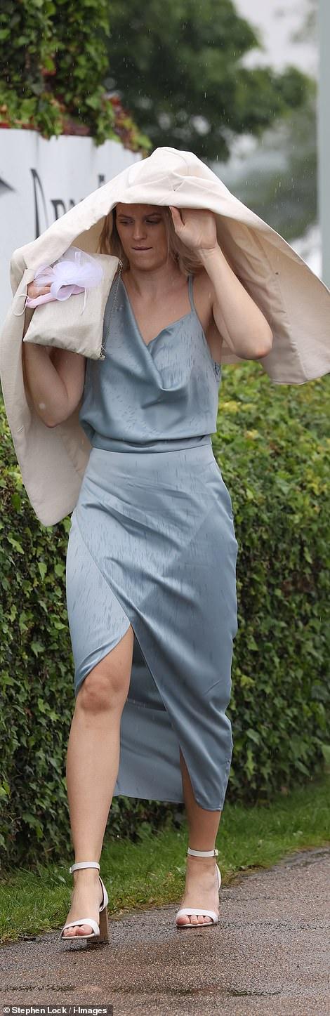 A lady looks wonderful in a silk blue dress,