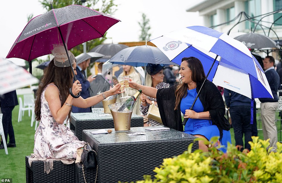 Cheers to that! Prosecco and champagne was flowing as the heavens opened on the Surrey racecourse today