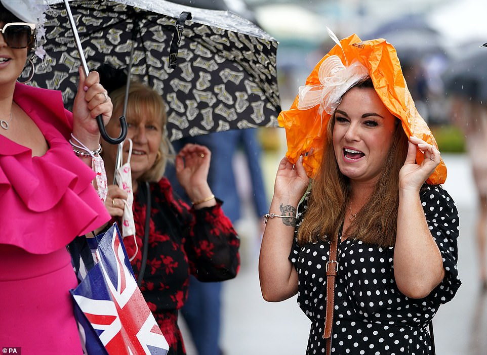 Another racegoer got creative and used a carrier bag to shelter from the drizzly weather conditions