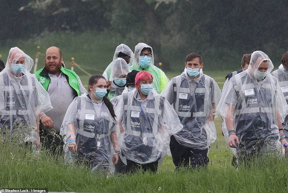 Staff donned ponchos as they were seen arriving for Ladies Day at the start of the Epsom Derby Festival at Epsom Racecourse