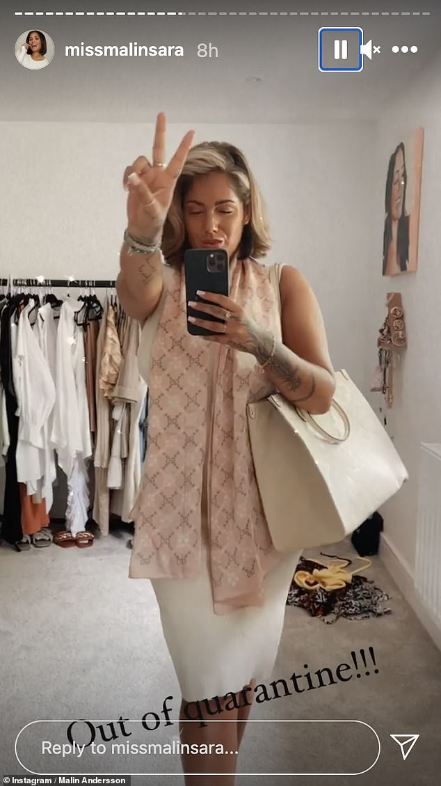 Celebration time: Malin cut a chic figure in a white dress and pink scarf as she headed to her relaxing weekend away on Friday