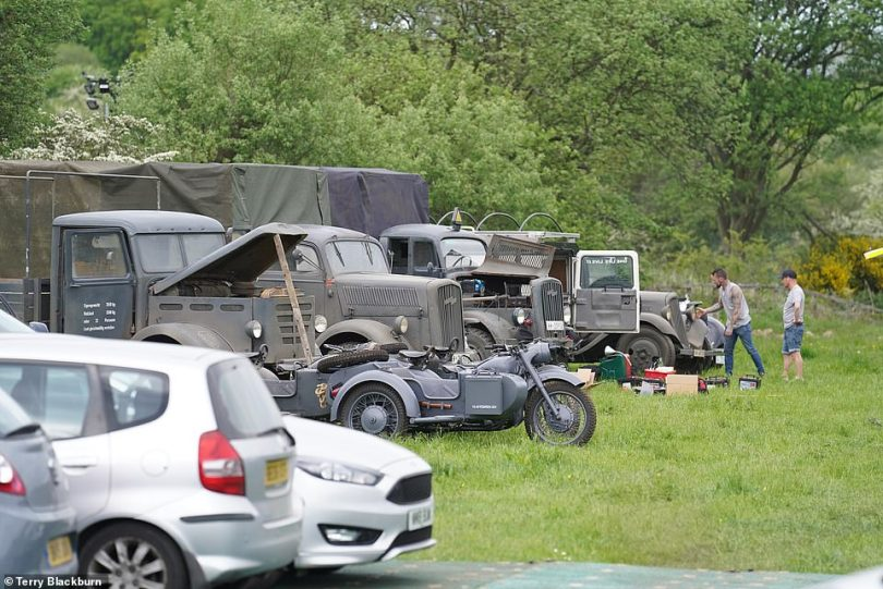 Line-up: A selection of motors which will feature in Indiana Jones 5 could be seen parked together on a grassy field