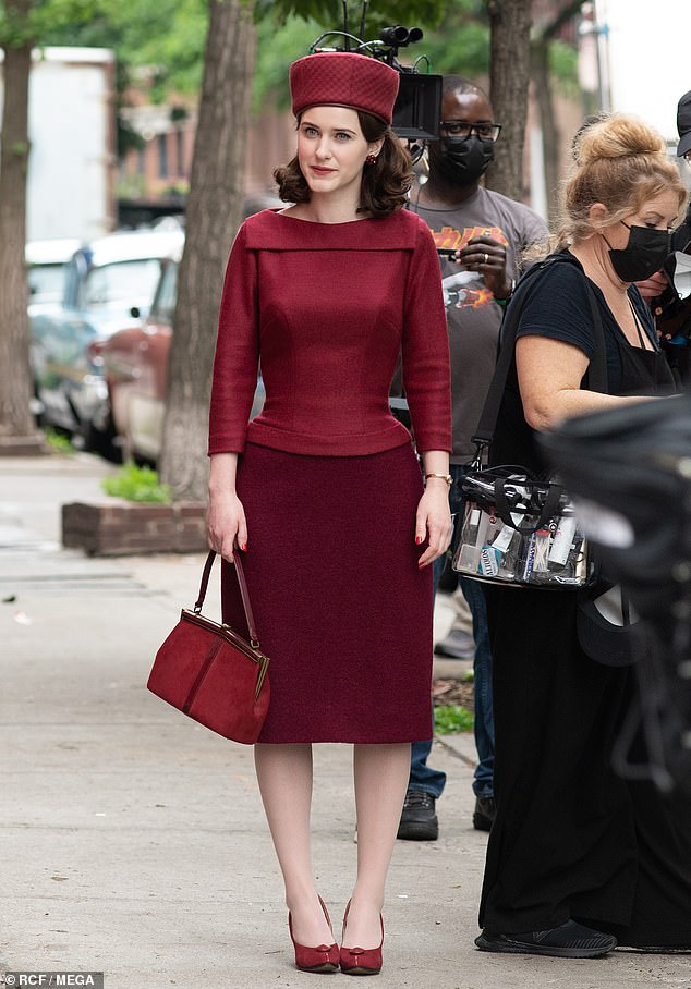 Set life: Rachel Brosnahan, 30, slips into a bold head-to-toe burgundy ensemble while filming The Marvelous Mrs. Maisel in Greenwich Village